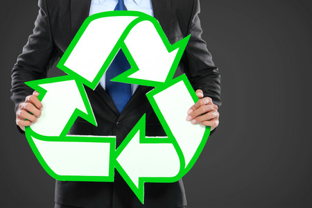 Portrait of businessman holding recycle sign icon photo