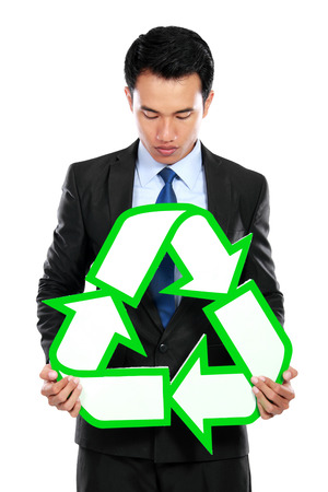 social awareness symbol: Portrait of businessman holding recycle sign over white background Stock Photo