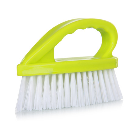 green cleaning Brush isolated over white background photo