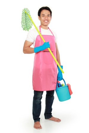 Portrait of young man with cleaning equipment isolated over white background photo
