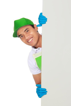 Cleaning service man presenting a blank board isolated over white background photo