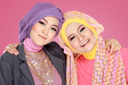 Portrait of close up two beautiful happy muslim woman photo