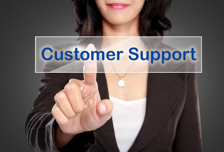 portrait of Businessman push to Customer support button on virtual screen photo