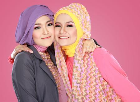 hijab: Portrait of close up two beautiful happy muslim woman