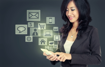 business woman smiling while using Modern communication technology mobile phone concept on high tech background photo