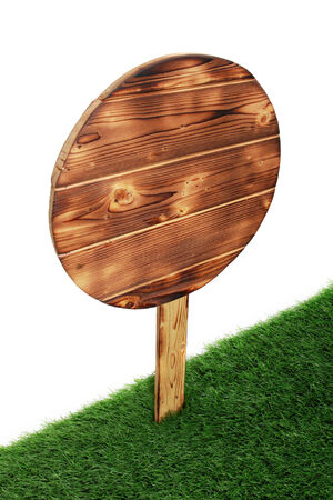 Wooden sign isolated on white. Wood old planks sign on the green grass photo