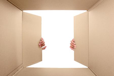 potrait: hand open cardboard box. potrait from inside the box Stock Photo