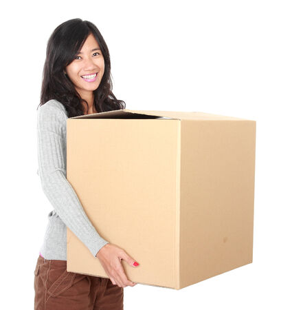 woman with her stuff inside the cardboard box ready to move. moving day concept photo