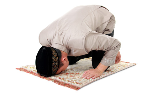 praying: man muslim doing prayer isolated over white background