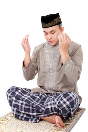 man muslim doing prayer isolated over white background photo