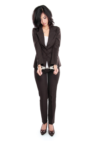 young  cuffs: Young business woman in handcuffs isolated on white