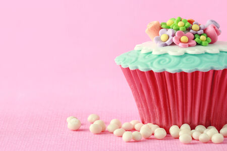 Sweet Cupcake with flower decoration in pink Stock Photo - 26258807