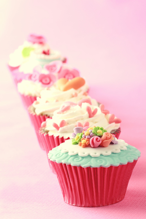 sweet cupcakes decorated with sugar paste and cream Stock Photo - 26258812