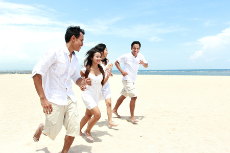 Group Of young Friends Enjoying Beach Together photo