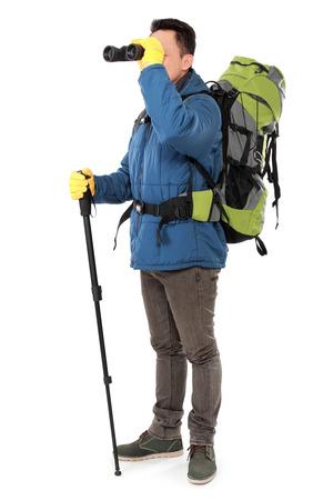 looking around: Hiker man tourist looking around with binoculars. Hiking. Isolated over white background Stock Photo
