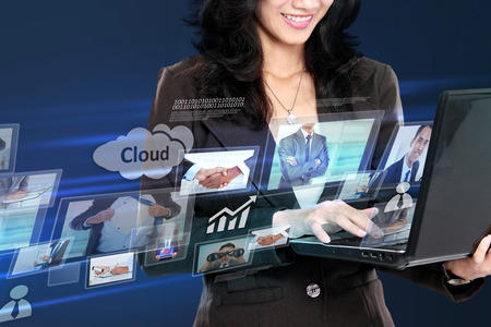 communication tools: business woman in hightech cloud computing concept working with laptop. conceptual image
