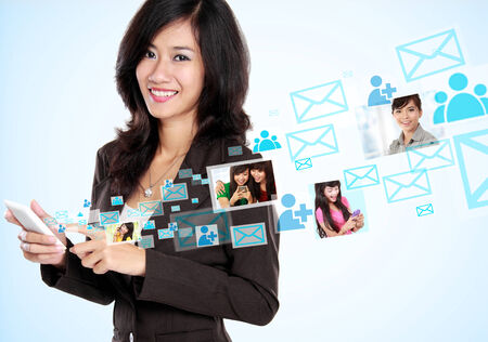 Happy businesswoman receiving and sending email. social media hightech concept photo