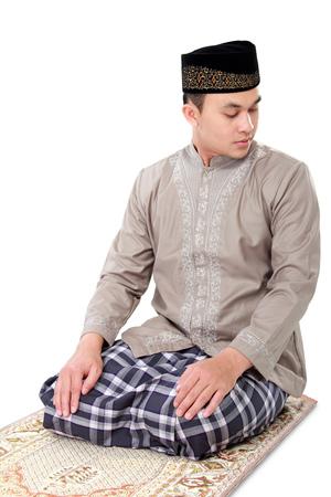 muslim prayer: man muslim doing prayer isolated over white background