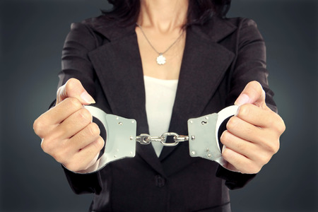 white collar crime: close up portrait of Young business woman in handcuffs. crime concept