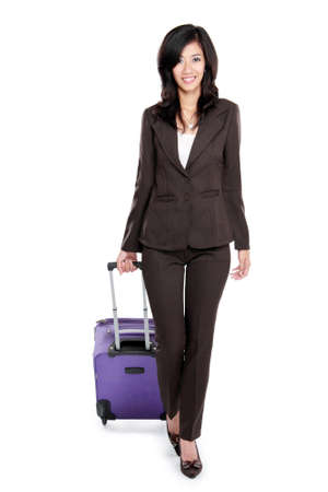 full body portrait of Smiling young business woman with suitcase isolated on white background photo