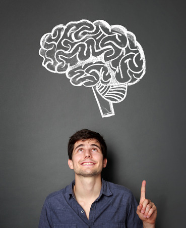 him: portrait of handsome young man with brain drawing icon on top of him. idea concept Stock Photo