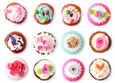 overhead view: cupcakes with beautiful decoration isolated over white background. shoot from top