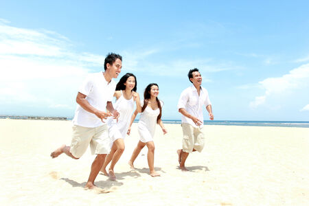 Group Of young Friends Enjoying Beach Together Stock Photo