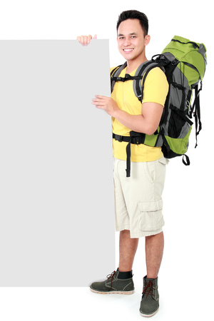 Hiker man tourist  with blank board. Hiking. Isolated over white background photo