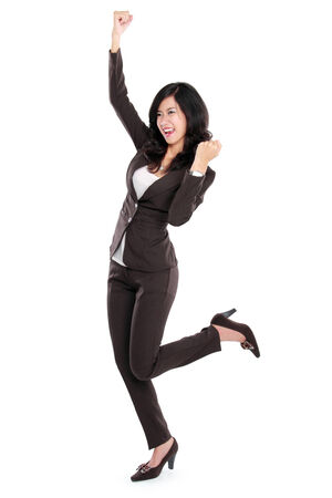 Excited businesswoman very Excited. happy asian business woman isolated in full length on white background. photo