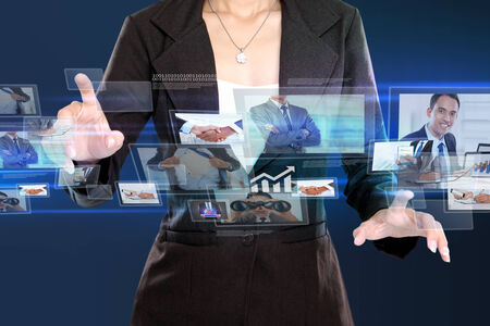 business woman in hightech concept. Conceptual image hand touching to virtual screen photo