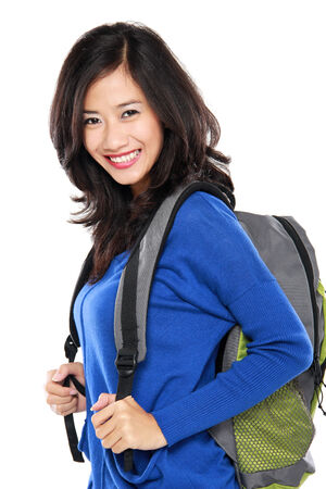 portrait of Young female happy student carrying bag isolated over white background photo