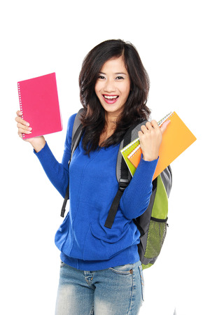 portrait of Young female happy student carrying bags and books photo