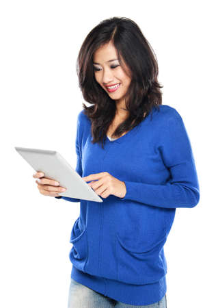 Woman holding tablet computer isolated on white background  working on touching screen photo
