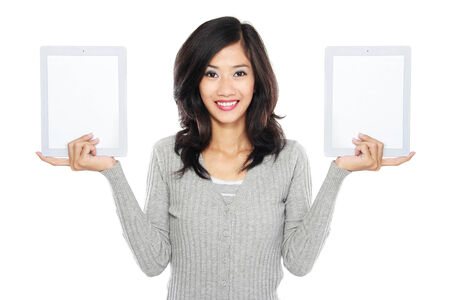 Woman showing two blank tablet computer screen  isolated over white background