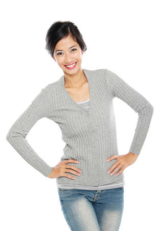 Asian woman isolated on white background. Casual woman smiling looking happy in grey sweater. photo