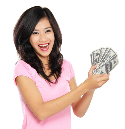 portrait of happy woman showing money isolated on white background photo