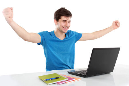 portrait of young student with arms raised using laptop photo