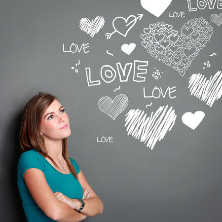 lifestyle looking lovely: portrait of beautiful girl looking up thinking of falling in love Stock Photo