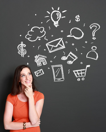 woman looking up: woman looking up to multimedia icon. high tech concept Stock Photo