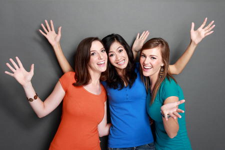 portrait of attractive multi racial three girls best friend together having fun photo