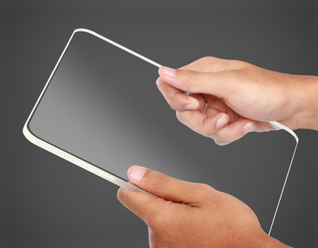 portrait of hands holding futuristic transparent tablet pc