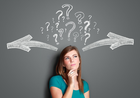 way of thinking: Pretty young woman making a decision with arrows and question mark above her head