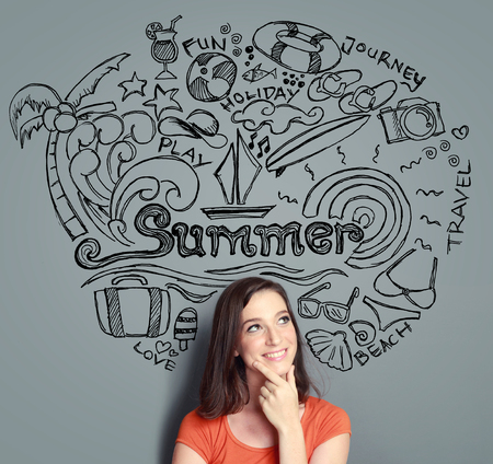 young woman smiling thinking of her summer vacation. Sketches on top of her. photo
