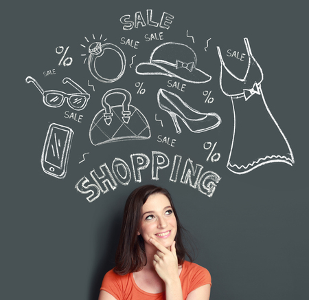 woman looking up: portrait of Happy young woman looking up thinking of buying or shopping something Stock Photo