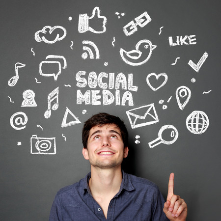 Young man looking up of Hand drawn illustration of social media sign and symbol doodles concept Stock Photo