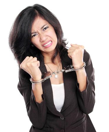 Junge Geschäftsfrau in Handschellen isoliert auf weiß Standard-Bild