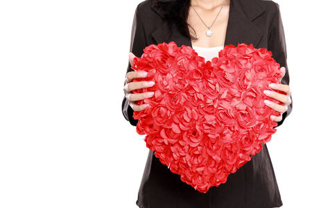 congenial: portrait of Business woman hand with red heart isolated on white