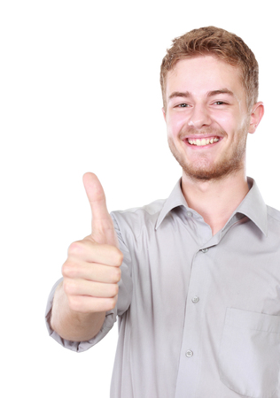 Portrait of young happy businessman showing thumb up photo