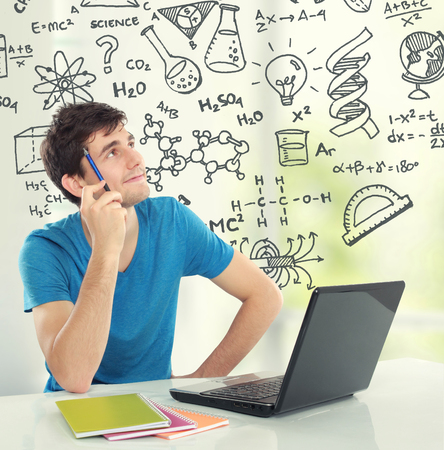 male university college student Thinking looking up some formula Stock Photo - 28396383