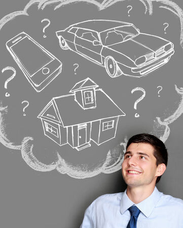 morgage: portrait of business man confuse of buying house, car or gadget Stock Photo